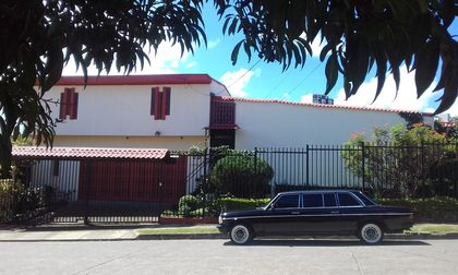 RED AND WHITE MANSION. COSTA RICA MERCEDES LIMO PICK UP SERVICE